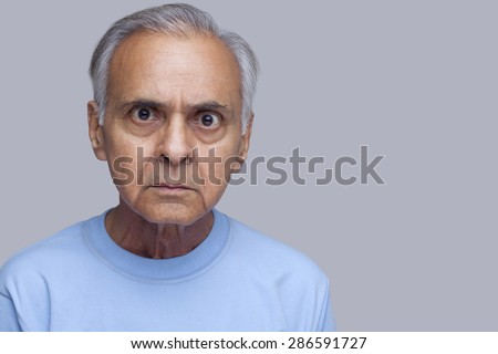 Portrait of angry old man