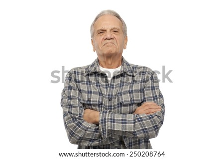 Portrait of angry senior man with arms crossed against white background - stock photo