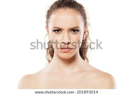 portrait of angry young girl on white background - stock photo