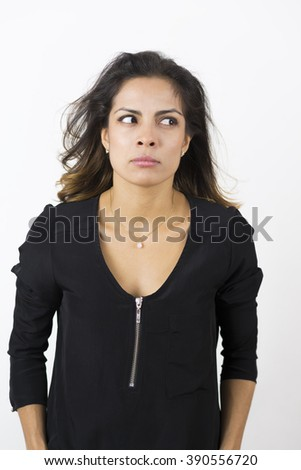 Portrait of Angry Young Woman Over White Background - stock photo
