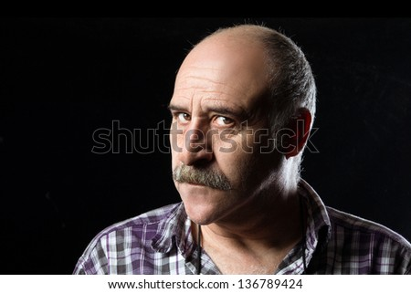Portrait of annoyed bald man with a big mustache expressing anger - stock photo