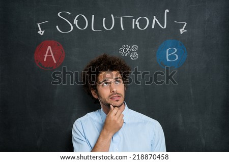 Portrait Of Anxious Business Man Thinking On Possible Solutions Over Gray Background - stock photo