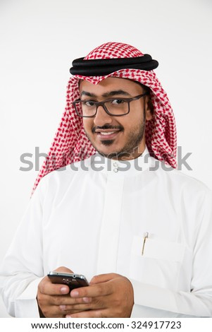 Portrait of Arab businessman messaging on mobile