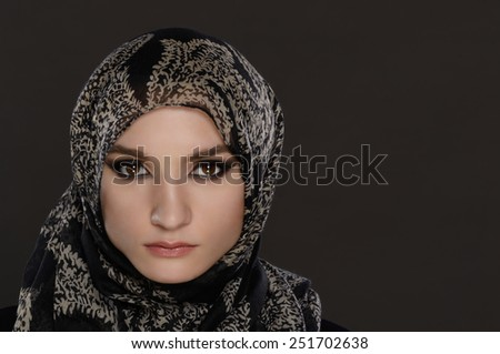 portrait of Arab woman on a gray background - stock photo