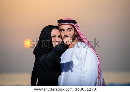 Portrait of Arabic dressed yang couple. - stock photo