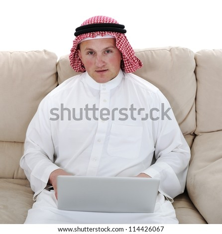 Portrait of Arabic man using laptop at home