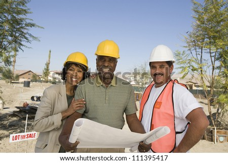 Portrait of architect and couple with blueprint discussing at construction site