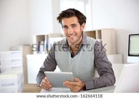 Portrait of architect using tablet in office - stock photo