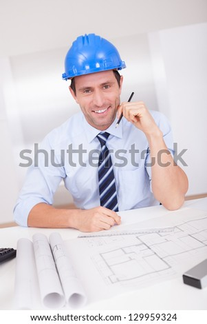 Portrait Of Architect With Blueprint In The Office - stock photo