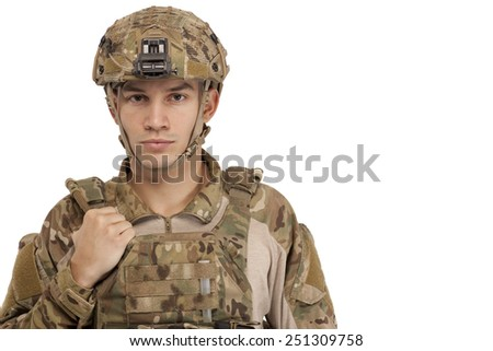 Portrait of army soldier wearing safety wear against white background - stock photo