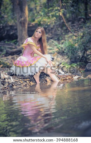 Portrait of asia beautiful girl in ballet dress on nature