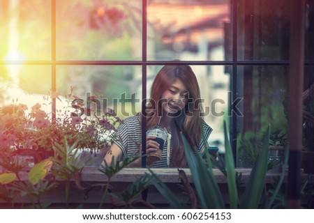 portrait of asia beautiful woman relax in coffee shop