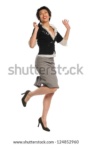 Portrait of Asian American businesswoman jumping isolated over white background - stock photo