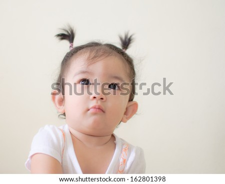portrait of asian baby girl, thinking