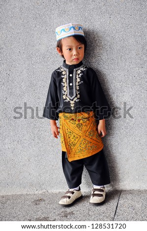 Portrait of asian boy with smile in malaysia dress