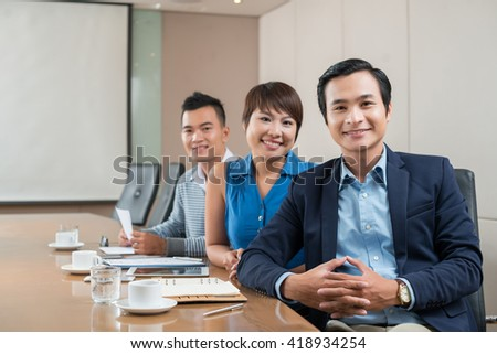 Portrait of Asian business colleagues in meeting room