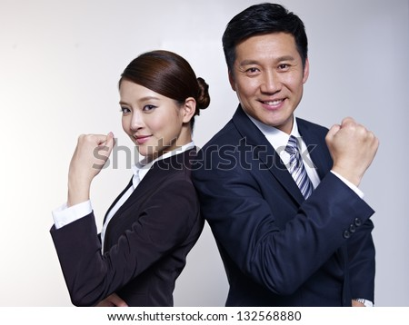 portrait of asian business people looking energetic. - stock photo