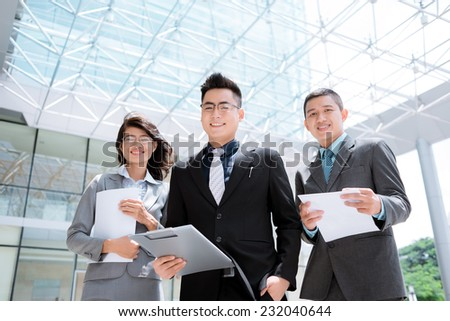 Portrait of Asian business team looking at the camera - stock photo