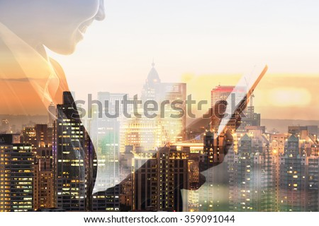Portrait of Asian business woman using tablet in a room, concept of technology or communication. - stock photo
