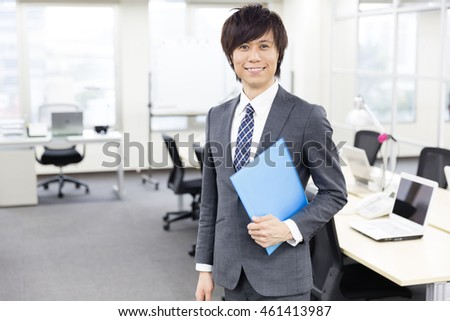 portrait of asian businessman in office