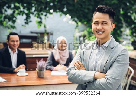 portrait of asian Businessman leader on the foreground of his team - stock photo