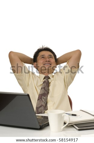 Portrait of Asian businessman sitting back and relaxing - stock photo