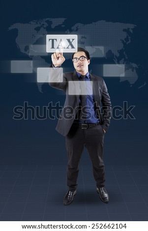 Portrait of asian businessman using modern interface to access his tax