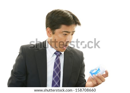 Portrait of Asian businessman who has no time