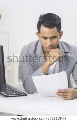 Portrait of asian businessman working on his paperwork in the office