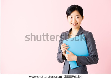 portrait of asian businesswoman isolated on pink background