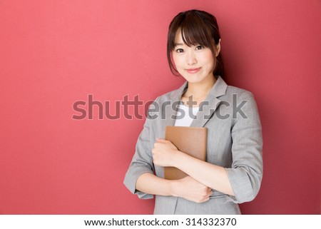 portrait of asian businesswoman isolated on red background
