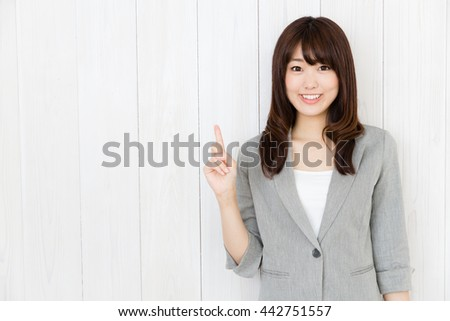 portrait of asian businesswoman isolated on wood background