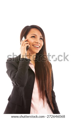 Portrait of asian businesswoman smiling while phoning over white isolated background - stock photo