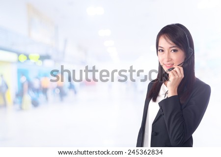 portrait of asian businesswomen has airport background ..Mixed Asian / Caucasian businesswoman. - stock photo