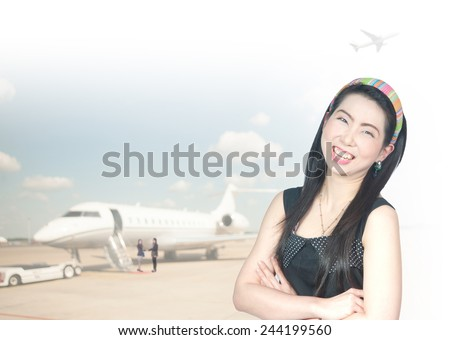 portrait of asian businesswomen has background of airport - stock photo