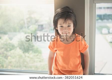 Portrait of asian  child smiling,vintage filter - stock photo