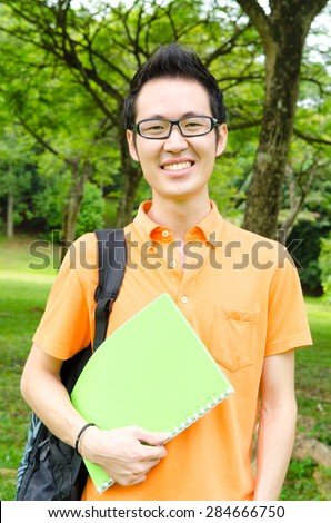 Portrait of asian college student - stock photo