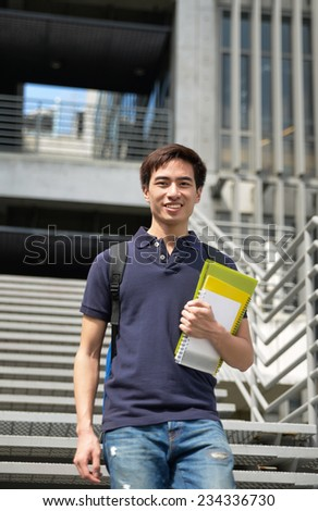 Portrait of Asian college student at his university - stock photo