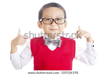 Portrait of asian elementary school student and thumbs-up. shot in studio isolated on white