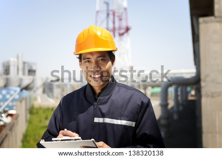 Portrait of asian engineer smiling  look on you camera