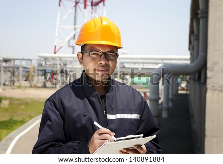 Portrait of asian engineer smiling  look on you camera - stock photo
