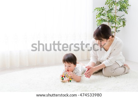 portrait of asian family playing in the room