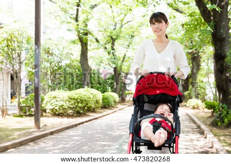 portrait of asian family relaxing in the park