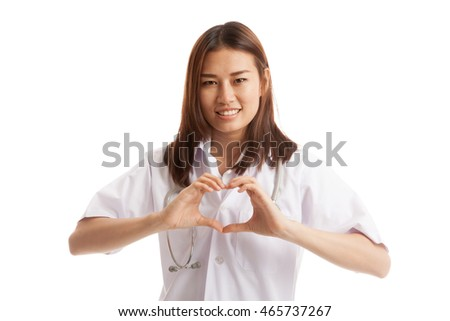 Portrait of Asian female doctor show heart hand sign  isolated on white background.