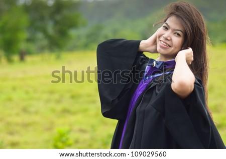 Portrait of Asian female graduate in Thailand - stock photo