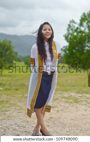 Portrait of Asian female graduate in Thailand - stock photo