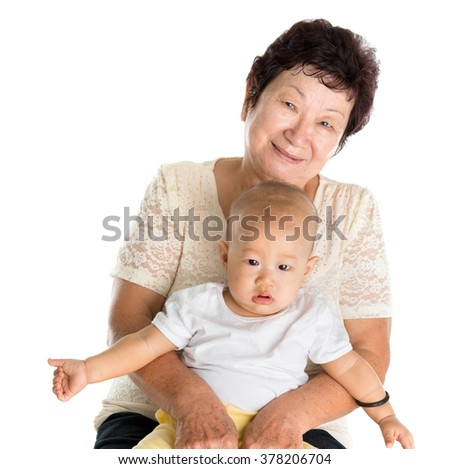 Portrait of Asian grandmother and grandson, isolated on white background. - stock photo