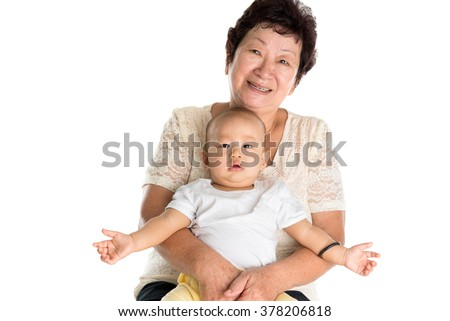 Portrait of Asian grandmother and grandson. Isolated on white background. - stock photo