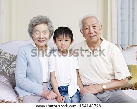 portrait of asian grandparents and grandson - stock photo