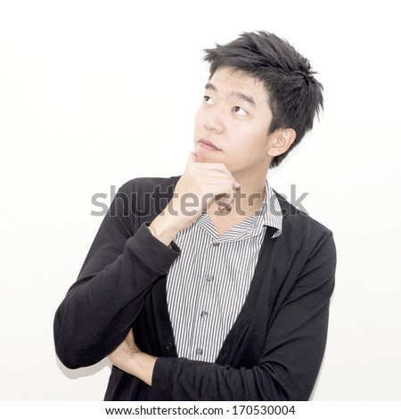 Portrait of asian handsome young thoughtful man isolated over white background
